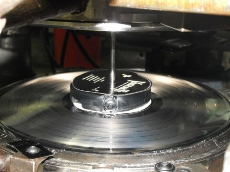 Record presses close under a pressure of about 150 tons.