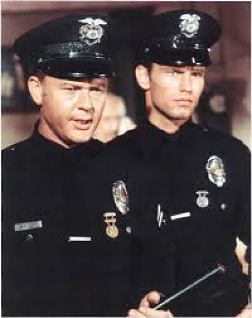 "Milner, left, as ""officer Pete Malloy, and Kent McCord as ""officer Jim Reid"""