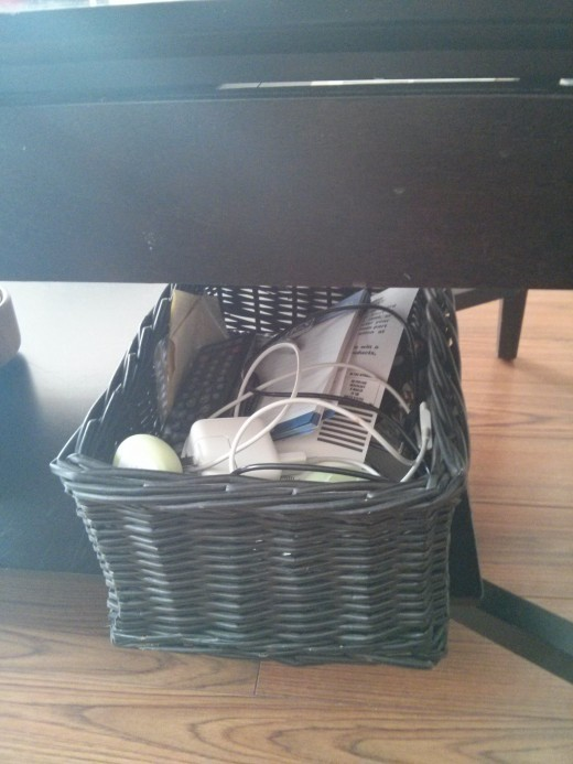 Keep a decorative basket under the coffee table to throw remotes, chargers, pens and miscellaneous junk into.