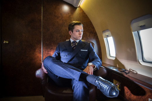 Taron Egerton as Eggsy in a very X-Men:First Class looking plane interior.