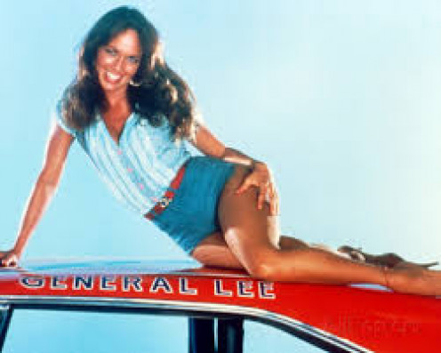 "Catherine Bach  atop the ""General Lee"""