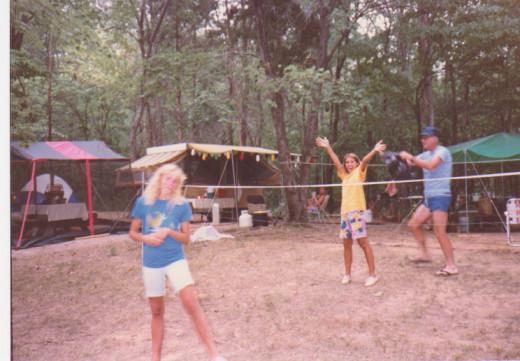 My sister Sara and me playing volleyball with my sister's father in-law trying to put my sister in a bag.
