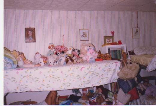 My  bunk bed with homemade comforter and all my stuffed animals.