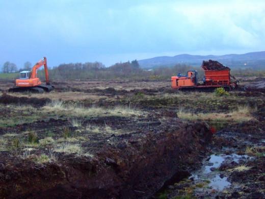 Hopper Machine extruding turf on bog surface