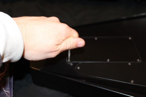 Use a screwdriver to remove the back plate