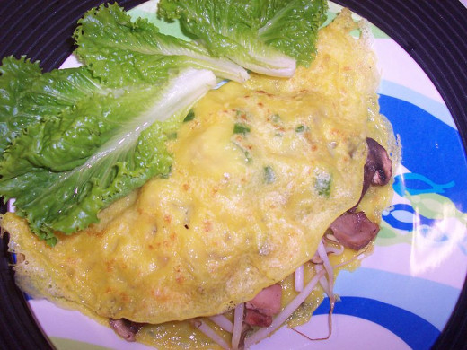 Banh xeo pancakes are traditionally served cupped within lettuce leaves
