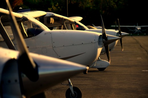 Cessna 172 at flight school ramp lined up at sunset