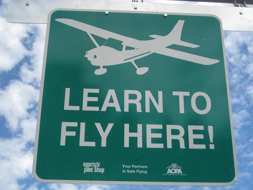 Sign post showing flight school ahead