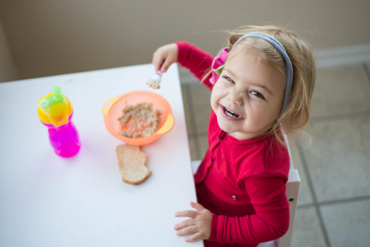 A soft headband can help prevent small children from putting things in their ears.