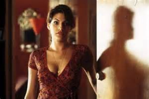 Eva Mendes stars as Denzel Washington's leading lady if you will. She has a son with Detective Harris and wants to protect him.