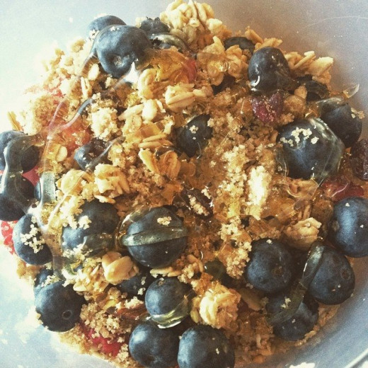 strawberries, blueberries, and bananas with vanilla greek yogurt and granola. Topped with brown sugar and honey.