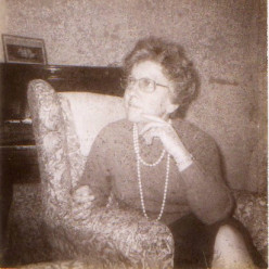Norah, my mother, in front of her piano
