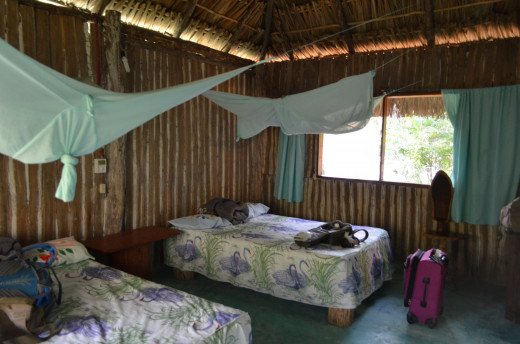 Interior of cabana at Cabanas Calakmul. The room is comfortable with plenty of outlets for charging phones, etc. and the private bathroom has hot showers. Mosquito netting was not even necessary as the windows have screens.