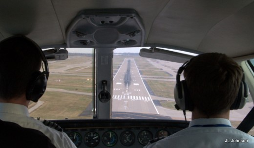 Cessna 402C approaching to Lambert St. Louis International's runway 12R for landing.