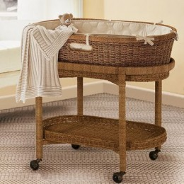 PotteryBarn Kids bassinet alternate view without hood 2007. not sure if they make these still or if they'll bring them back, but you can see what the under-storage looks like. Continue to check in with them for new styles, often brought seasonally.
