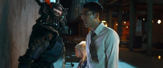 Sharlto Copley (left) as Chappie and Dev Patel as designer of the Scout bots and Chappie Deon Wilson