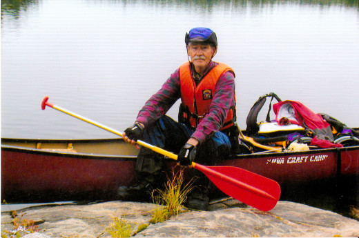 Joe canoeing at Red Lake, Canada. They go from lake to lake.