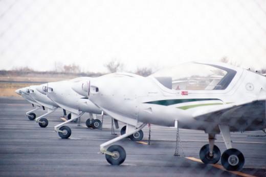 Flight school training aircraft parked at ramp.