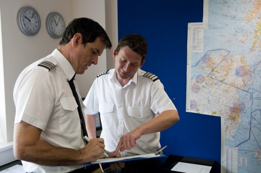 Flight instructor checking student pilot's flight planning, mainly flight calculation and weather report. If you cannot understand anything don't hesitate to ask your instructor.