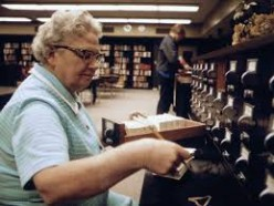 A stereotypical librarian filing her library cards