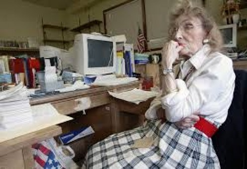 Senior librarian at work on computer
