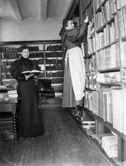 Librarians working in the library in the post-pioneer days