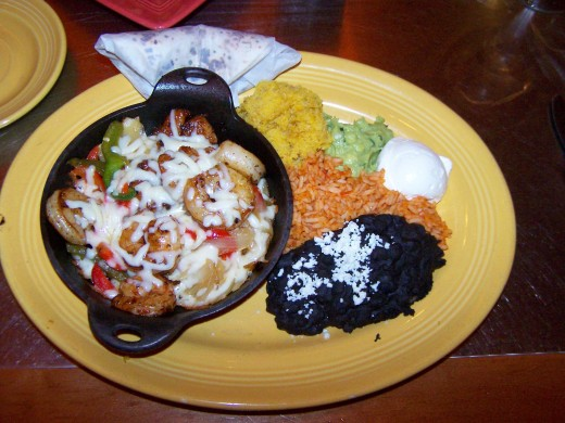 Served with  black refried beans, red spanish rice, polenta and fresh guacamole.