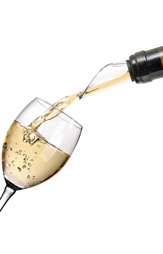 Pouring a glass red or white wine with a pourer is easy