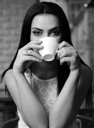This pretty brunette starts her day off right with a cup of fresh black coffee