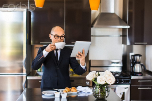 This businessman knows a good thing for he always has two cups of fresh coffee before he leaves his mansion for the office