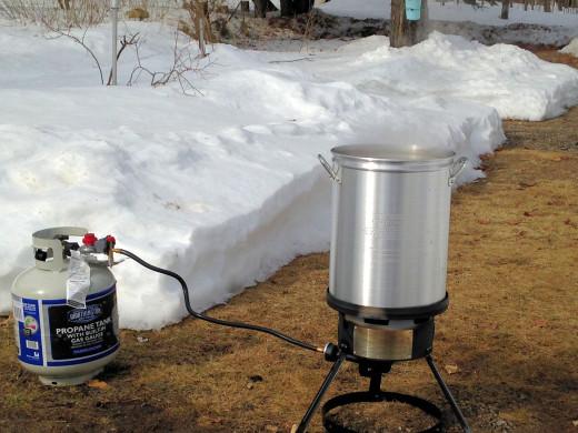 Boiling down Maple Sap
