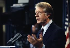 Former President Jimmy Carter talks to people about foreign policy