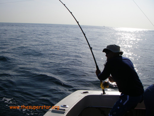 Improved apparel for fishing in salt water allows you to easily adjust to changing weather and temperature conditions.