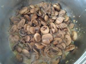 Add mushrooms to onions and garlic.