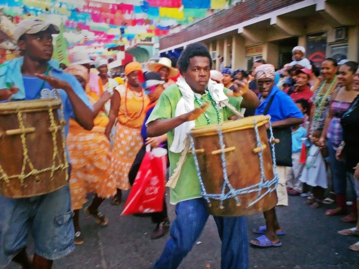 A musician playing a drum at the carnival