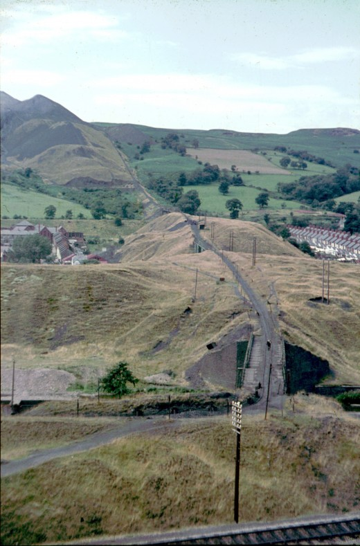 These heaps would tragically collapse less than two years after this picture of Aberfan was taken.