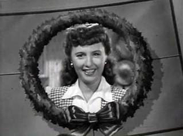 "Barbara Stanwyck gets laughs in ""Christmas in Connecticut."""