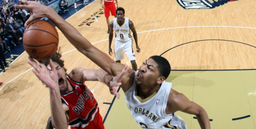 Anthony Davis(right) denies Robin Lopez(left)