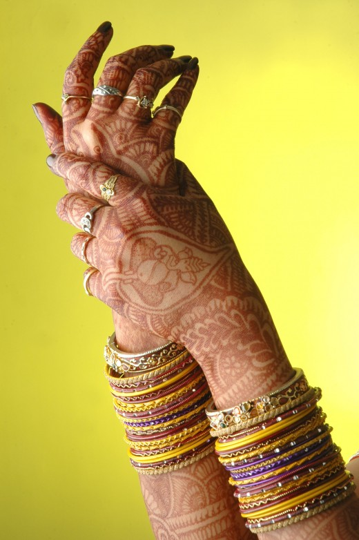 Henna is most commonly known for its use in intricate temporary tattoos traditionally drawn for weddings and celebrations.  However, Henna can be used to dye hair and fabric as well.