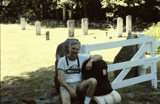 My Dad taking a break by a cemetery along the trail.