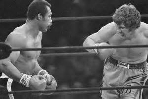 Ken Norton destroyed Duane Bobick in less than one round in their heavyweight clash.