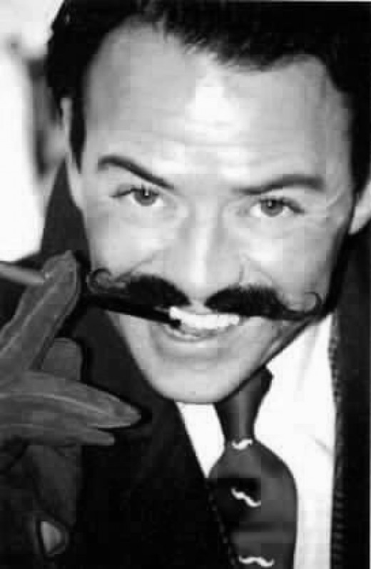 A handlebar mustache can make you seem slightly eccentric, as it does the British humorist Michael Attree.