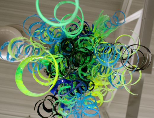 This is a beautiful up-cycle out of plastic bottles. I think I would add something to the ends for a wind-chime effect!