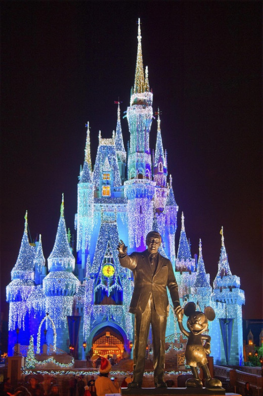What every person wants to see at Magic Kingdom...Cinderella's Castle and the state of Walt Disney and Mickey Mouse.