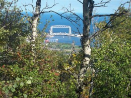A picture of the Aerial Lift Bridge through the trees up in the Park by Enger Tower