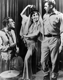 Jerry, left, played drums and banjo for the belly dancer, center, for a carnival that came to Mayberry. Andy Taylor, right, had to send it down the road for the dancer being too suggestive