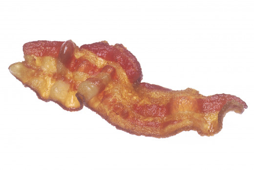 A strip of pan fried bacon.  This particular strip is on the chewy, as opposed to the crispy side.