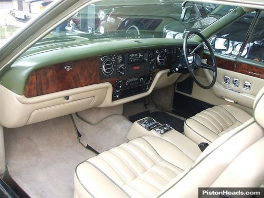Cream leather seats edged with green piping.