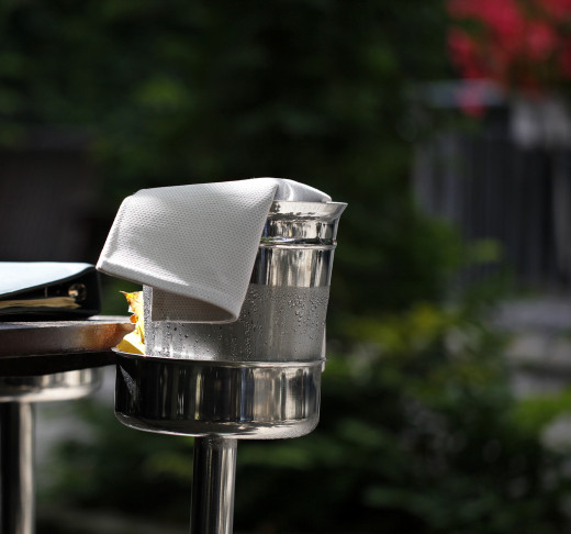 An ice bucket is the old fashioned way to keep wine cooled