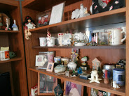 The shelves in my tiny apartment are filled with family photos and gifts from my family.